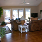 Great room with fireplace and new TV as seen from front entrance. House also has wireless Internet access.